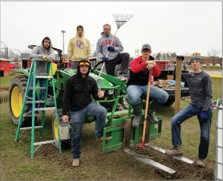 Leos help prepare the ball fields for the coming season.