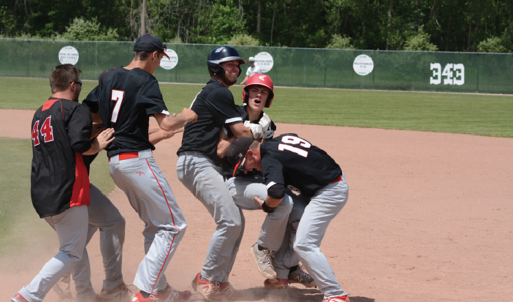The Beavers celebrate after Carson Oldani's walkoff single against Evart.
