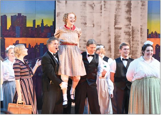 """The cast of Annie performs """"I Think I'm Going to Like It Here""""."""
