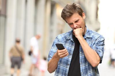 furious angry man watching social media