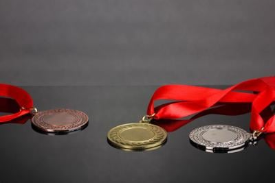 Three medals on grey background