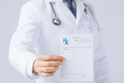 Doctor wth RX paper in hand