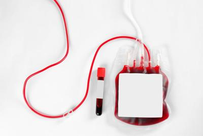 Blood pack for transfusion and test tube on white background, top view. Donation day