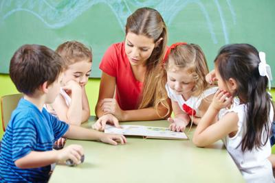 teacher reading book aloud to children Peoria Unified School District