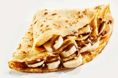 Fresh banana crepes drizzled with chocolate sauce