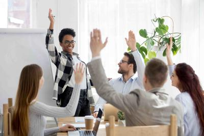 Diverse business people group raise hands at corporate presentation training