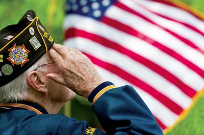 Veteran salutes flag