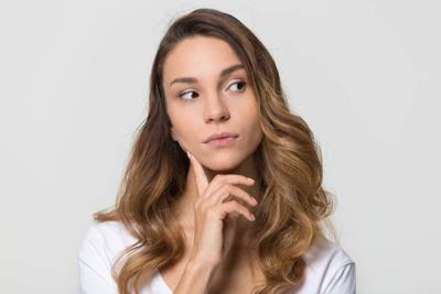 Thoughtful woman looking away feeling doubt isolated on white background