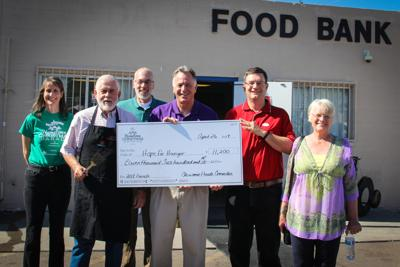 Christmas parade funds presented to local food bank