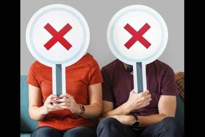 People holding incorrect tick boxes on couch