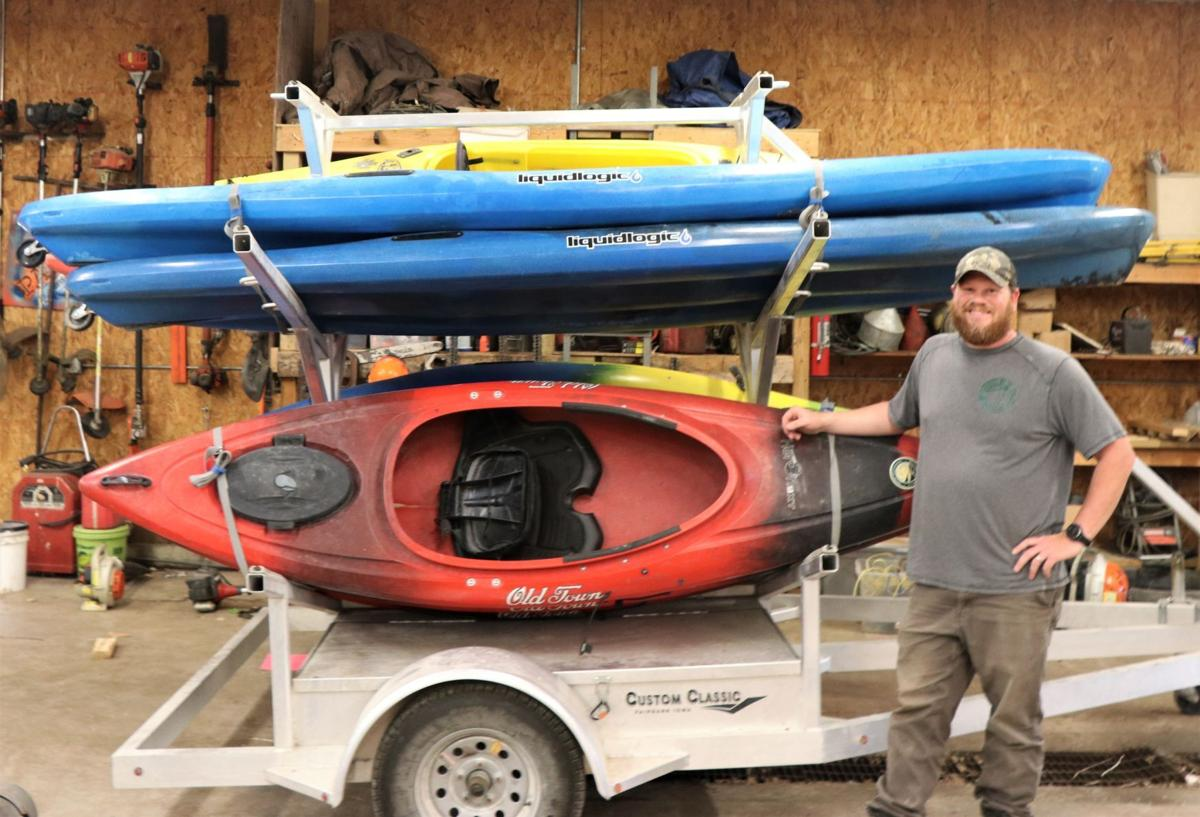 Andy Taets with kayaks