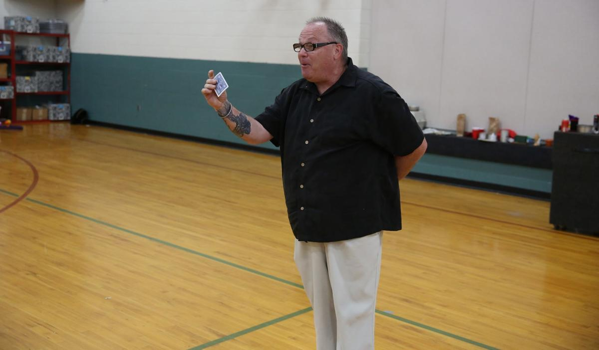 Troy Levenhagen- Holding a card