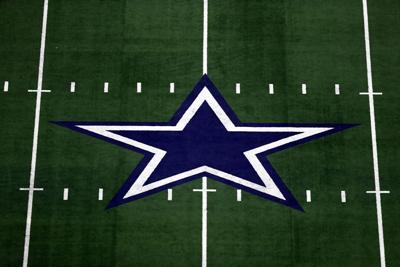 The Dallas Cowboys logo at AT&T Stadium on Sept. 30, 2018 in Arlington, Texas.