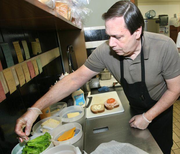 Preparing a deli lunch