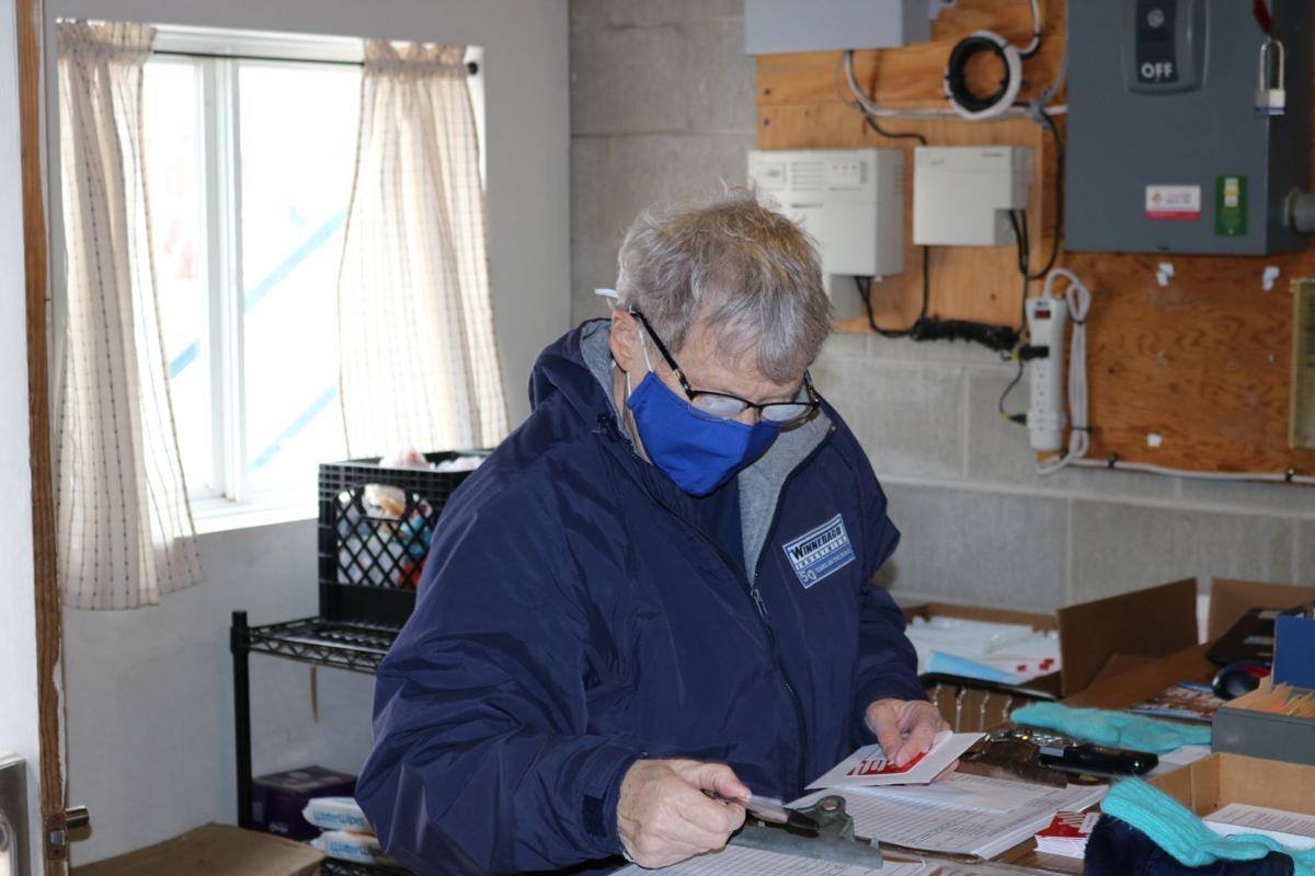 Bonnie Nyhus Checking Food Orders.JPG (copy)