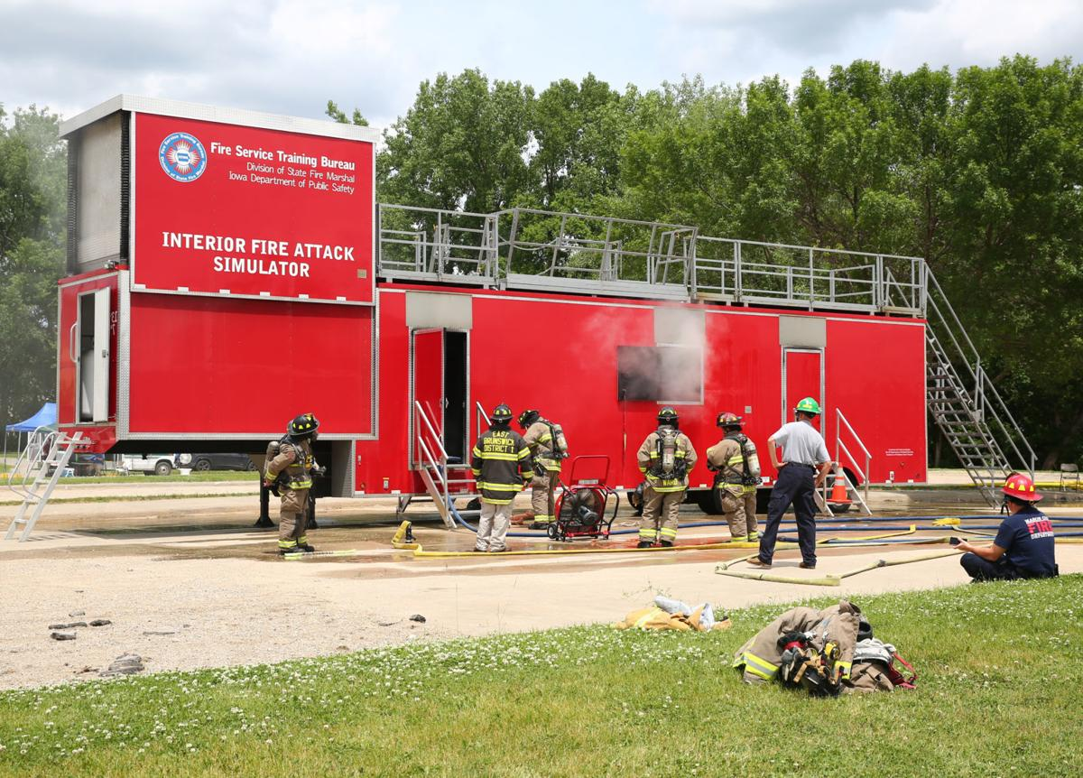 Fire department practices putting out fires   Mason City