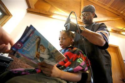 Iowa barber gives haircuts to children in exchange for them reading stories to him