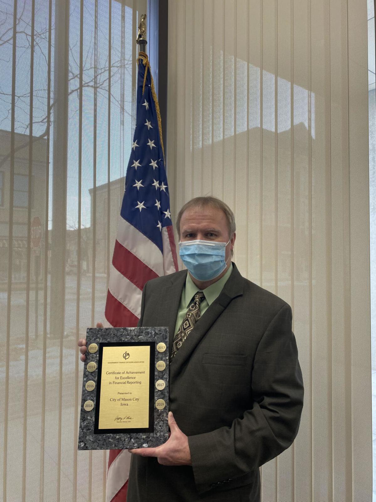 Kevin Jacobson receiving award