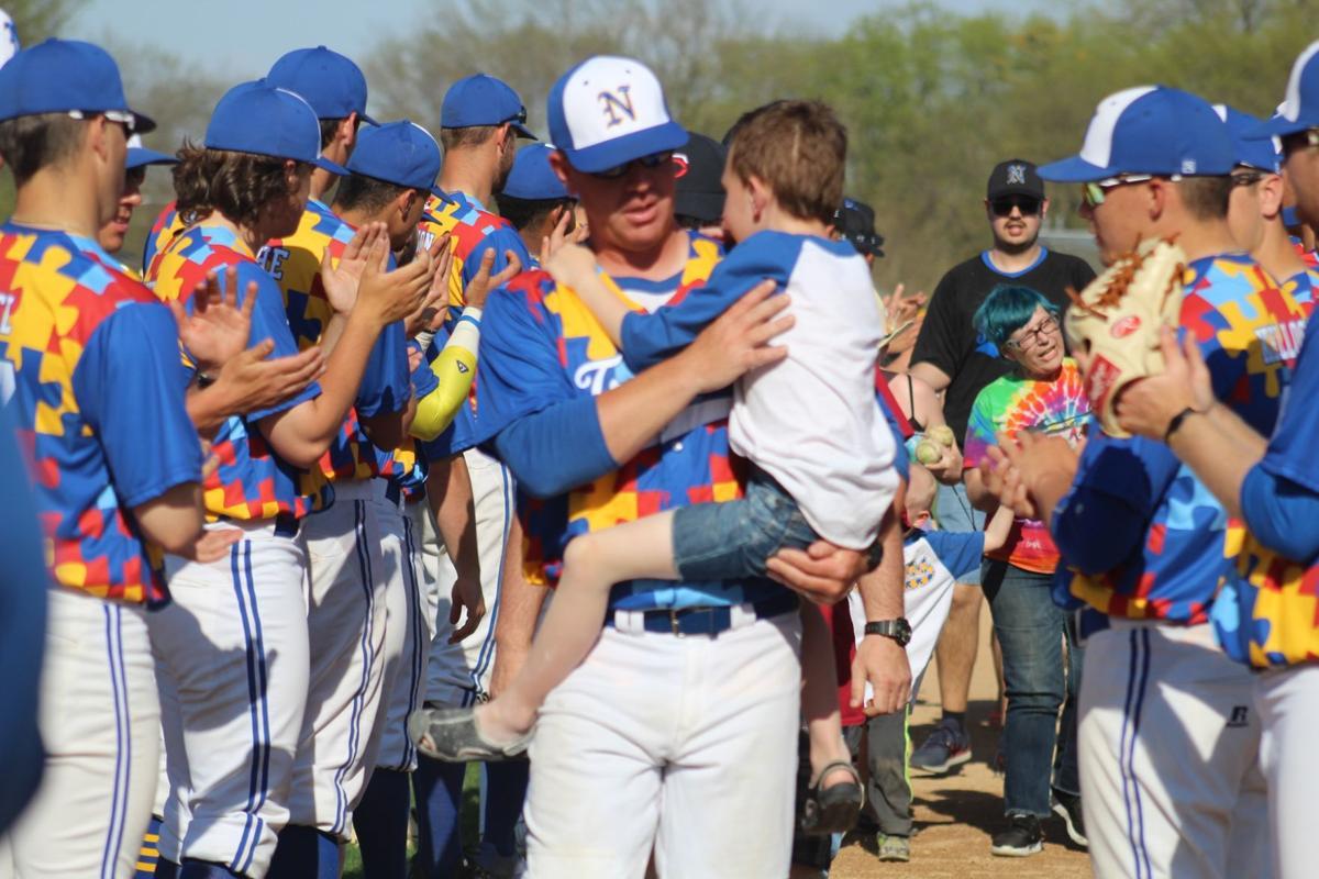 Travis Hergert and son