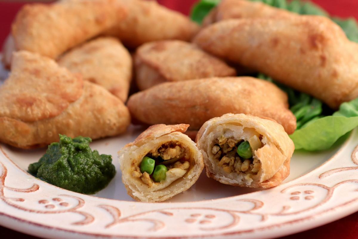 Chicken samosas with mint chutney.