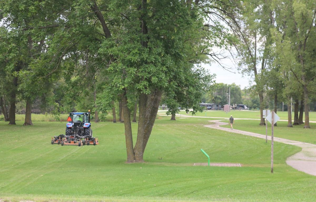 Forest City Parks Staff mows the Pammel Park grounds near where the new Korth Nature Trail connects to the Hynes Spur Trail.