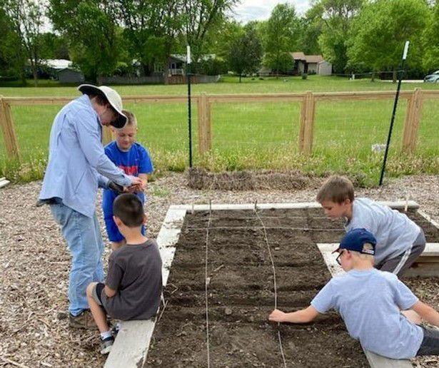 Forest City Y Kids Plant Gardens.jpg
