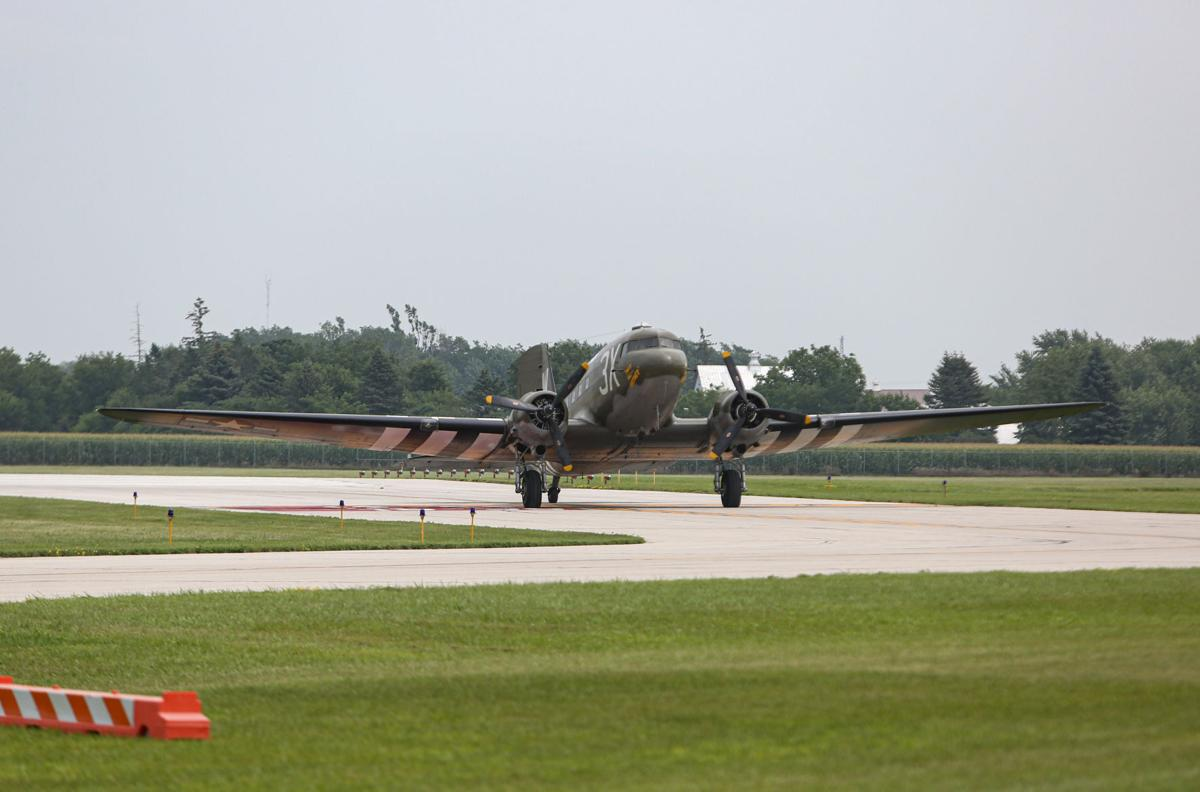 """WWII plane """"That's All, Brother"""" lands in Mason City"""