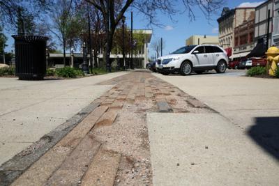 Crumbling bricks in the sidewalk on Federal Avenue