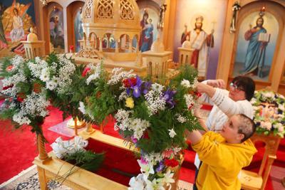 Mason City Greek Orthodox Christians decorate tomb for Holy