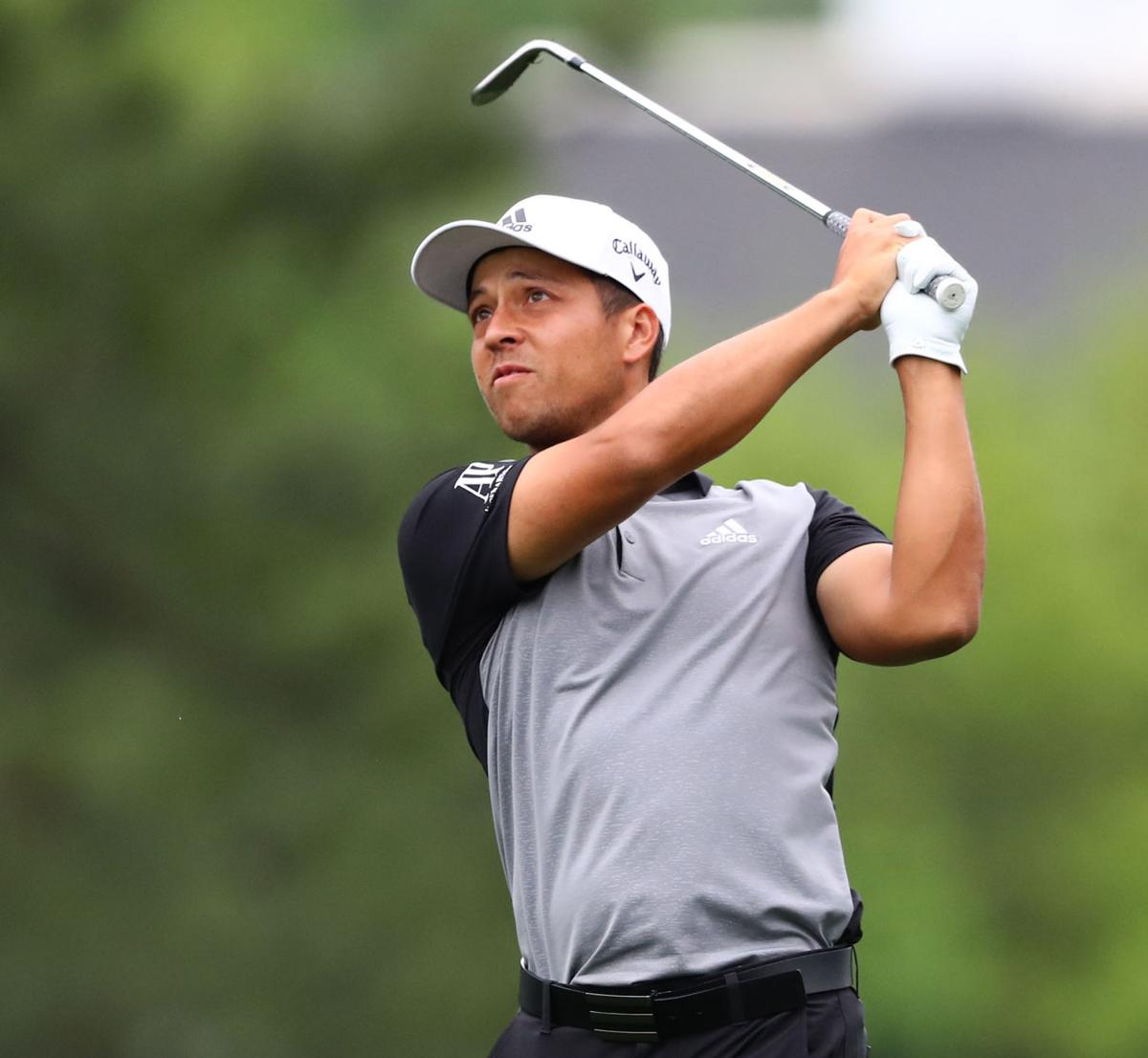 Xander Schauffele hits his fairway shot on 1 during the final round of the Masters on Sunday, April 14, 2019, in Augusta, Ga.