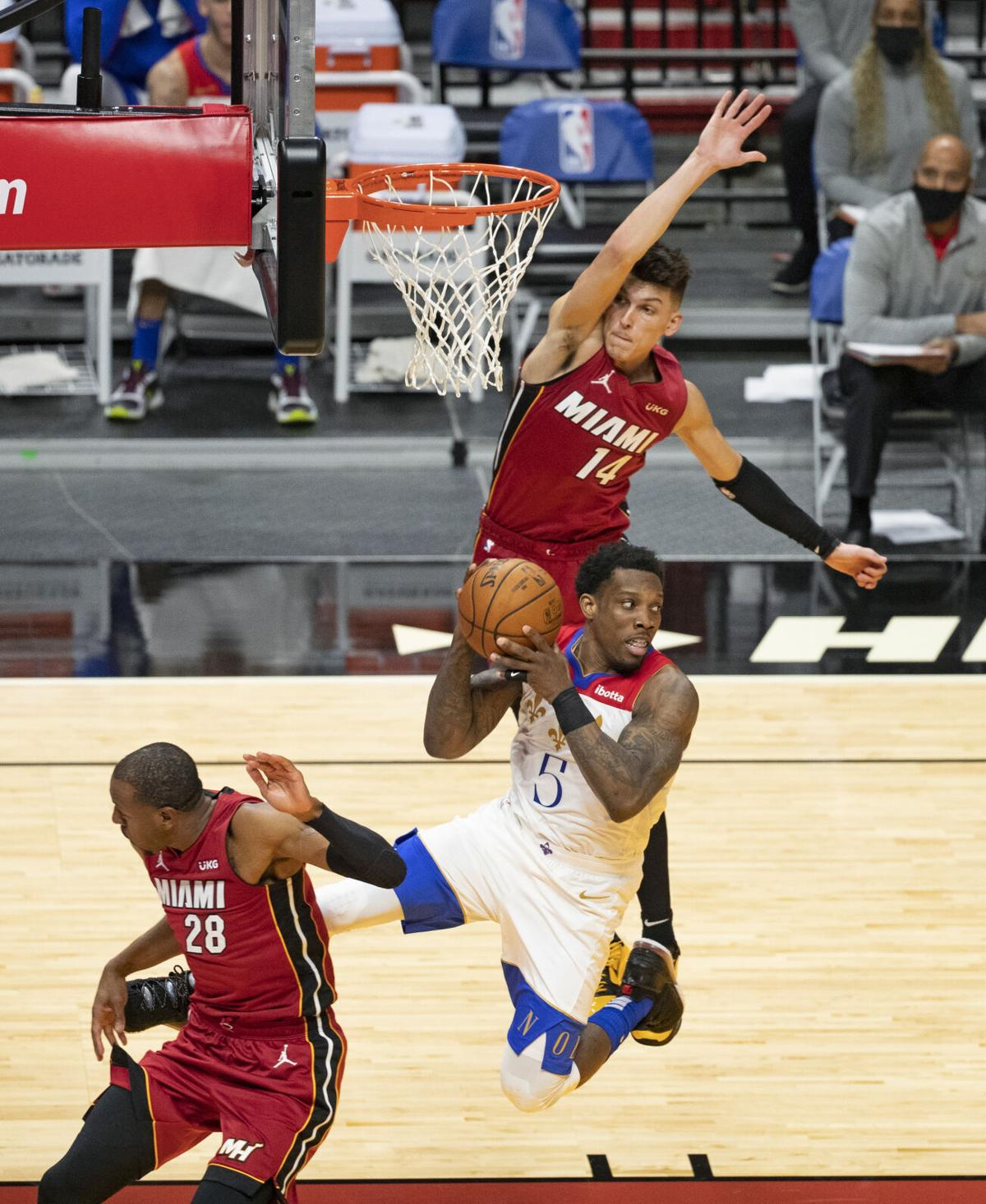 New Orleans Pelicans guard Eric Bledsoe looks to pass against Miami Heat guard Tyler Herro in the second quarter of a NBA basketball game on Christmas Day at the AmericanAirlines Arena on Friday, December 25, 2020.