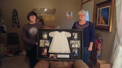 Lenz gives granddaughter baptism dress