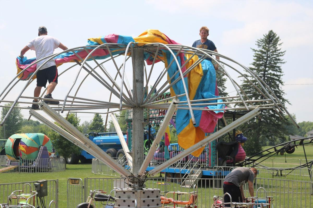 Carnival Workers Setting Up Canopy on Kiddie Ride.JPG