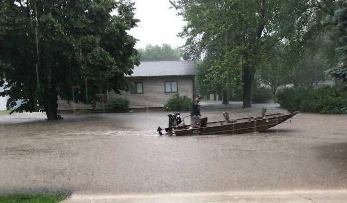 Man in boat, Forest City flooding
