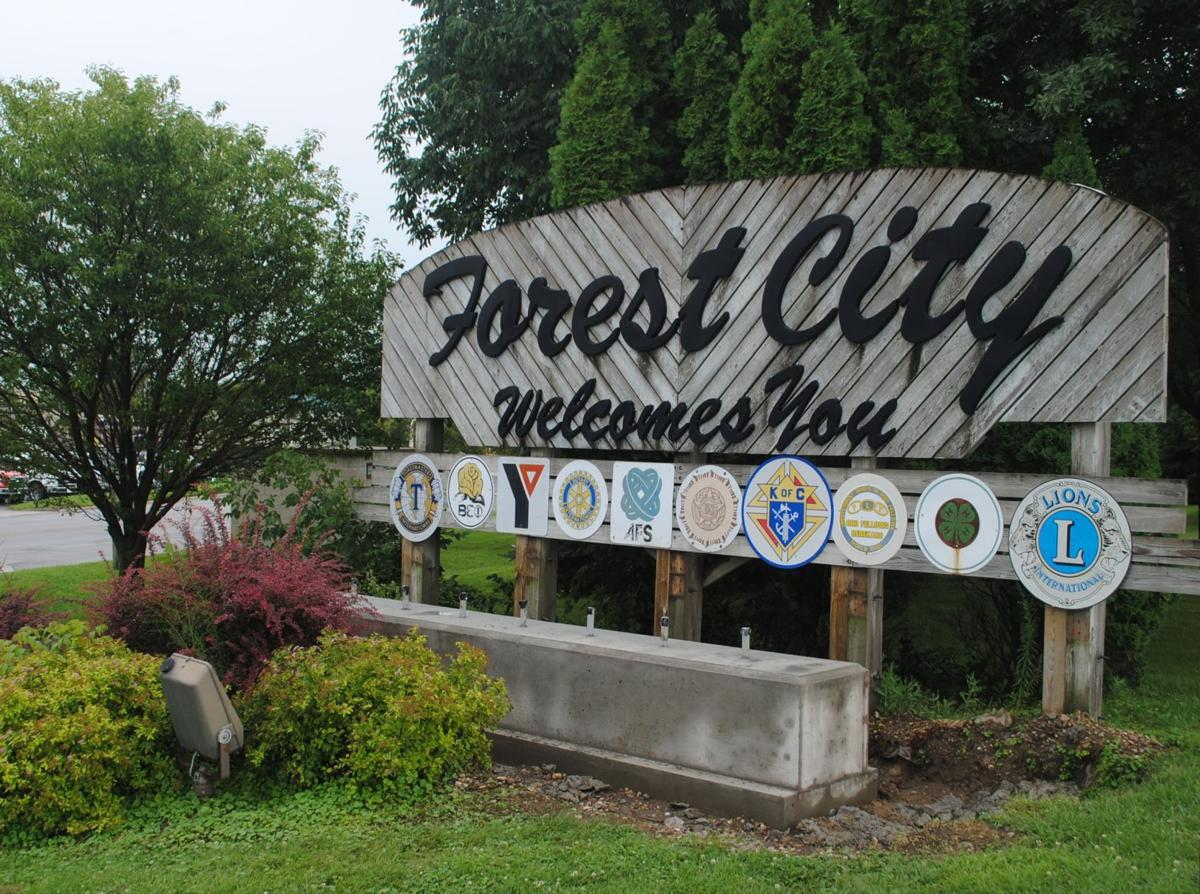 old welcome sign forest city