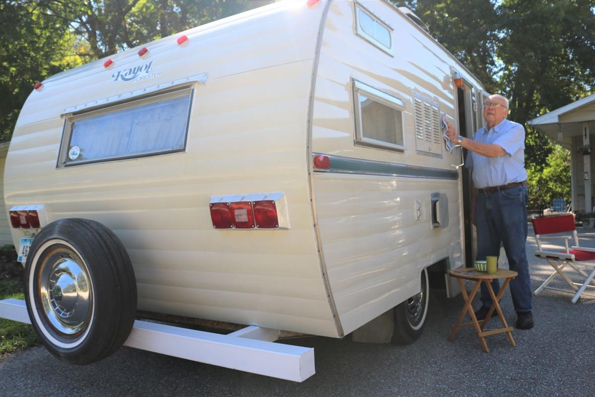 Marlen Hanson cleans his 1970 Forester 16 L camping trailer prior to the big Forester rally in Crystal Lake 2..JPG