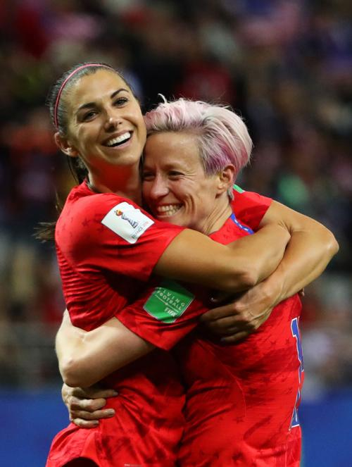 Alex Morgan of the USA celebrates with teammate Megan Rapinoe after scoring her team's twelfth goal during the 2019 FIFA Women's World Cup France group F match between USA and Thailand at Stade Auguste Delaune on June 11, 2019 in Reims, France.
