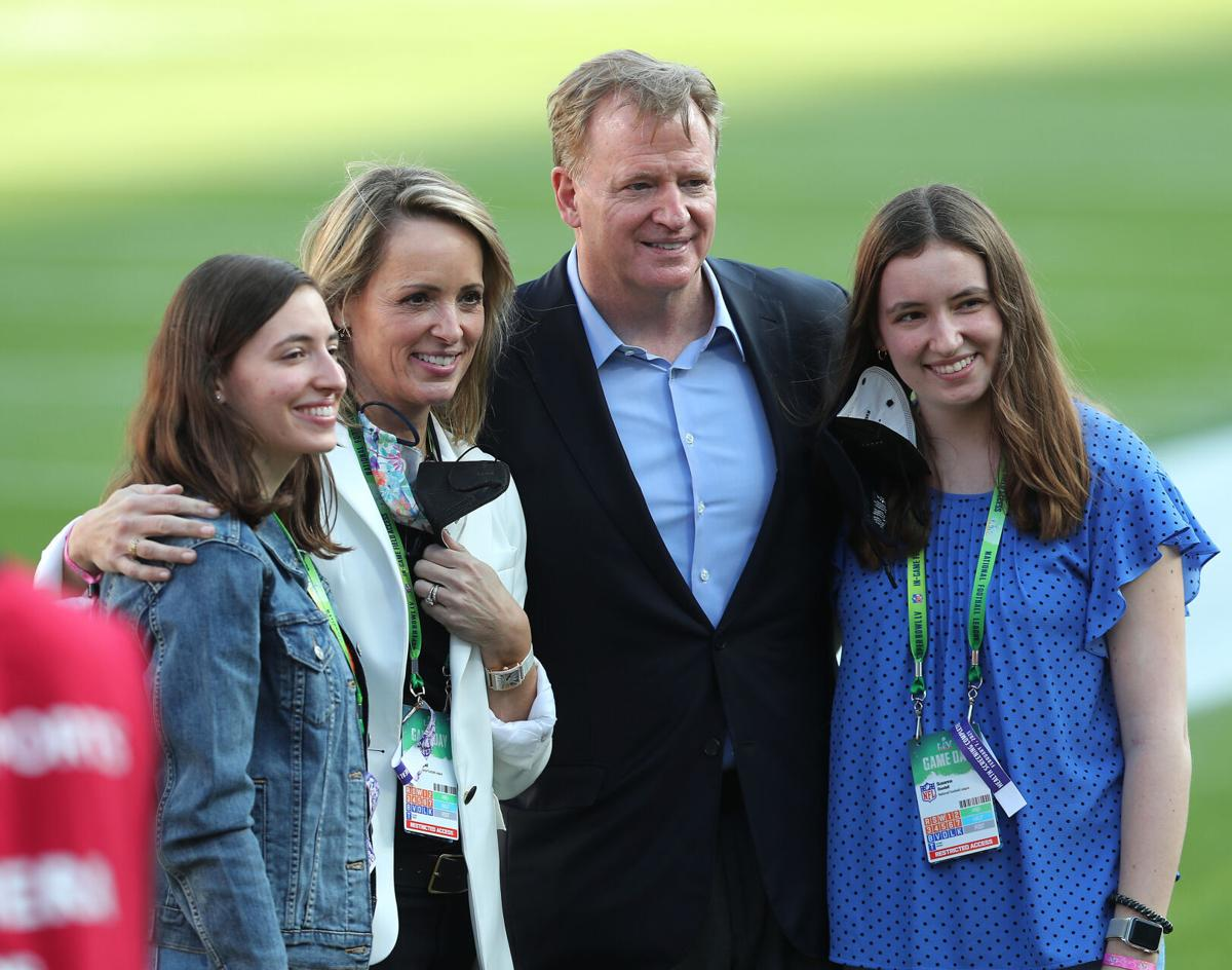 Roger Goodell, second from right, commissioner of the NFL, poses with football fans before the start of Super Bowl LV at Raymond James Stadium in Tampa, Florida, on Sunday, Feb. 7, 2021.
