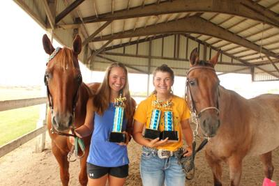 Julia May and Katelynn Huebsch with their horses