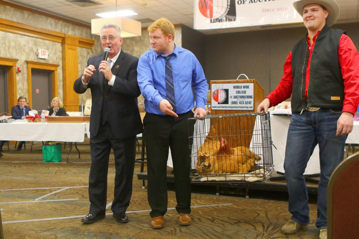 Paul Behr auctioning off chickens