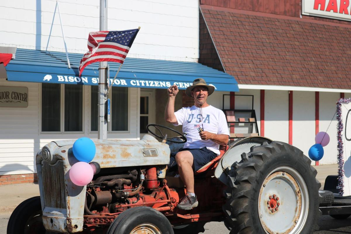 Jerry Wiedemeier throws pens from classic tractor.JPG