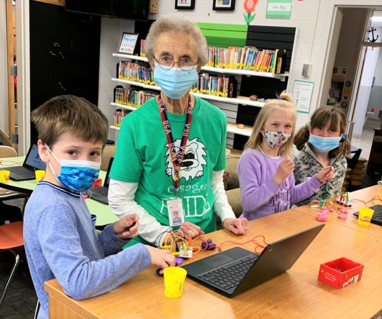 Grandma Sheral Tumilson and kids in library