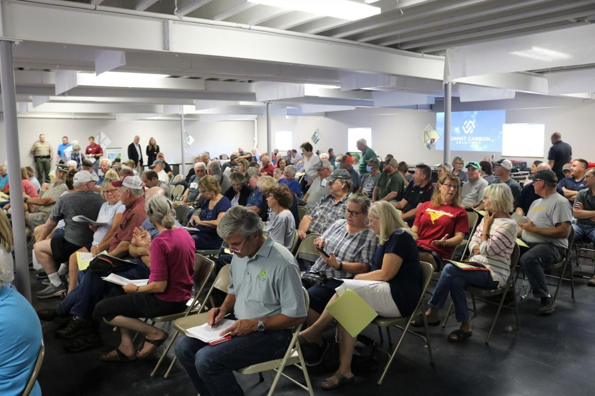 A large crowd gathered for a proposed pipeline meeting in the basement meeting room of the Viaduct Center in Garner on Sept. 28.JPG