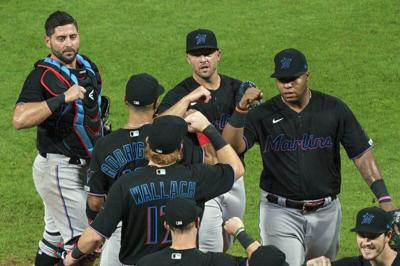MLB temporarily suspends Marlins season through the weekend