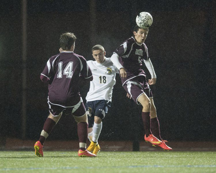 Rockport's Nick Sanfilippo (5) heads the ball toward teammate Jarrod Rostkowski (14) against St. Mary's in the Divison 4 North Quarterfinals Thursday night at Manning Field in Lynn.