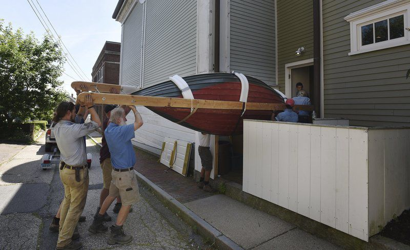 Museum installs 'peapod' boat for upcoming Winslow Homer show