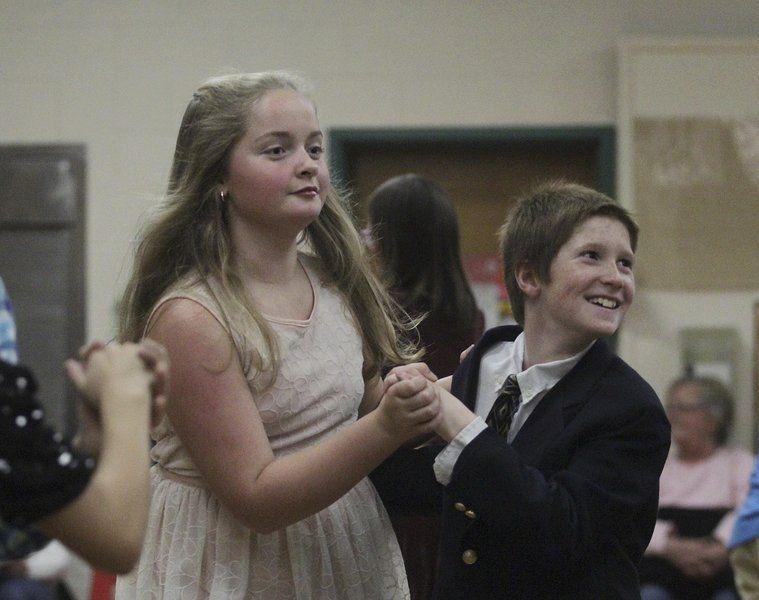 Fifth-graders Emma Ketchum and Ben DiFluri dance together during a ballroom dancing presentation last week at Essex Elementary School.