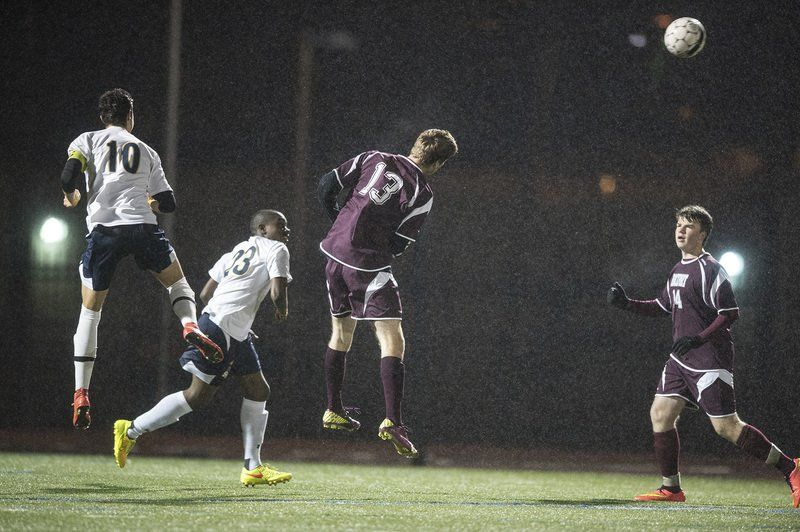 Rockport's Conor Kuykendall heads the ball away from St. Mary's in the Divison 4 North Quarterfinals Thursday night at Manning Field in Lynn.