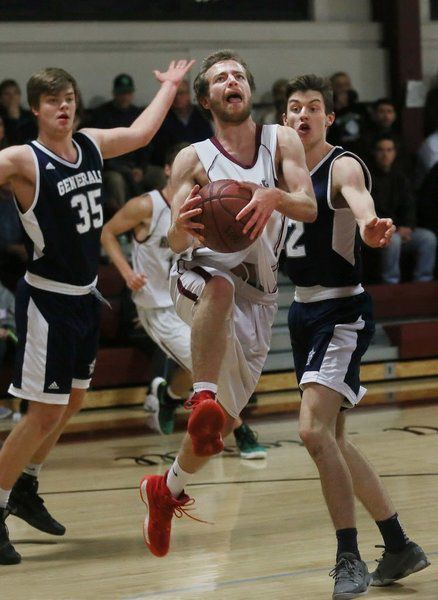 MIKE SPRINGER/Staff photo Rockport's Quinn Murdock drives to the basket in  between James Lustig (left) and Cam Grinnell of Hamilton-Wenham.g12/22/2017