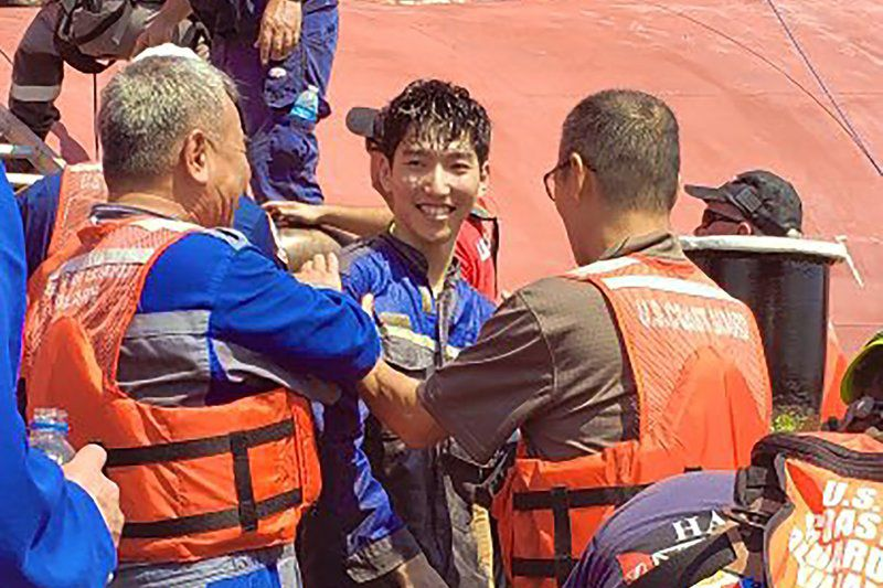 Rescued crewmen pulled from heat, darkness, deep water